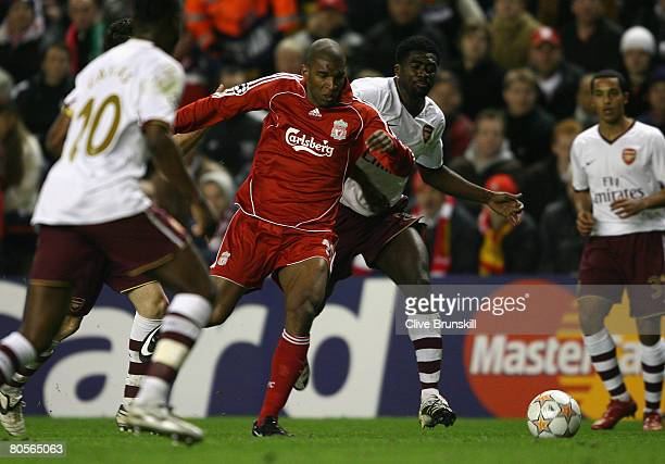 Ryan Babel of Liverpool is fouled by Kolo Toure of Arsenal to concede a penalty which led to Liverpool's third goal during the UEFA Champions League...