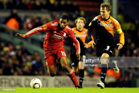Ryan Babel of Liverpool is pursued by Michael Silberbauer of FC Utrecht during the UEFA Europa League Group K match between Liverpool and FC Utrecht...