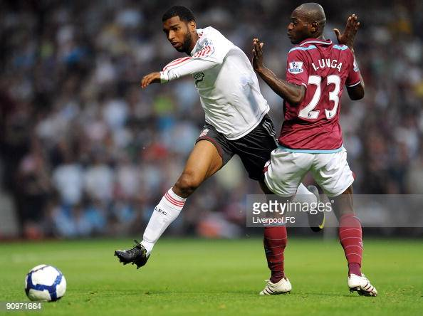 Ryan Babel of Liverpool runs round Herita Ilunga of West Ham during the Barclays Premier League match between West Ham and Liverpool at Upton Park on...