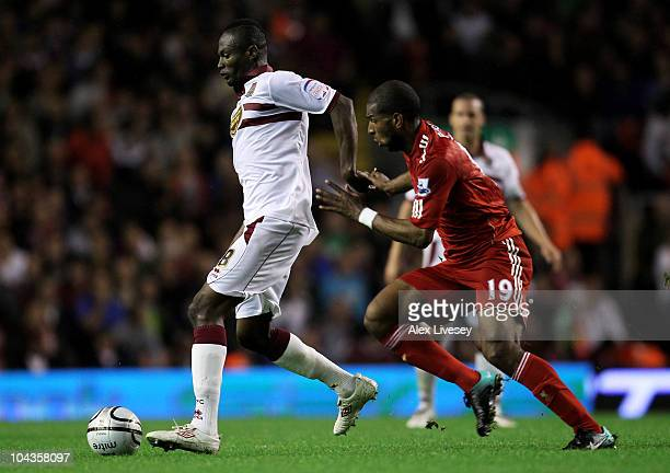 Ryan Babel of Liverpool tussles for posession with Abdul Osman of Northampton Town during the Carling Cup Third Round game between Liverpool and...