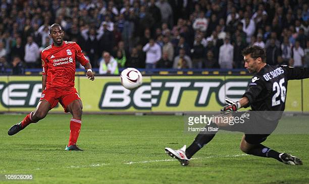 Ryan Babel of Liverpool watches a shot on goal deflected wide of the target by Morgan De Sanctis of Napoli during the UEFA Europa League match...