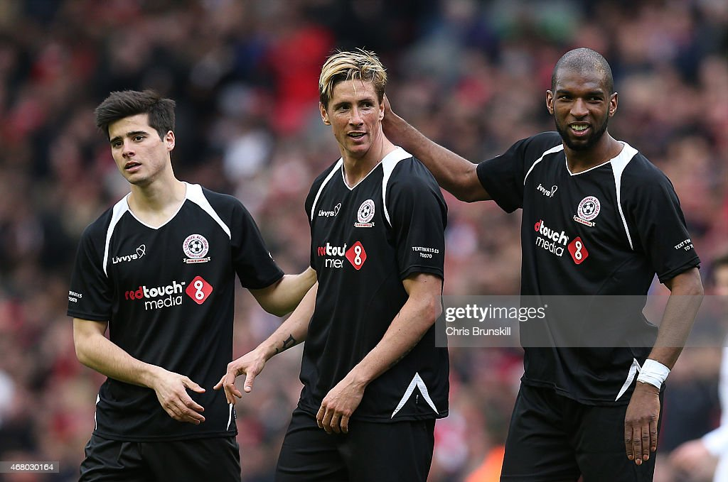 Ryan Babel of the Gerrard XI embraces teammate Fernando Torres at full time following the Liverpool AllStar Charity match at Anfield on March 29 2015...