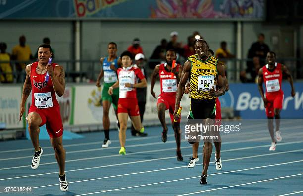 Ryan Bailey of the United States and Usain Bolt of Jamaica compete during the final of the men's 4 x 100 metres on day one of the IAAF World Relays...