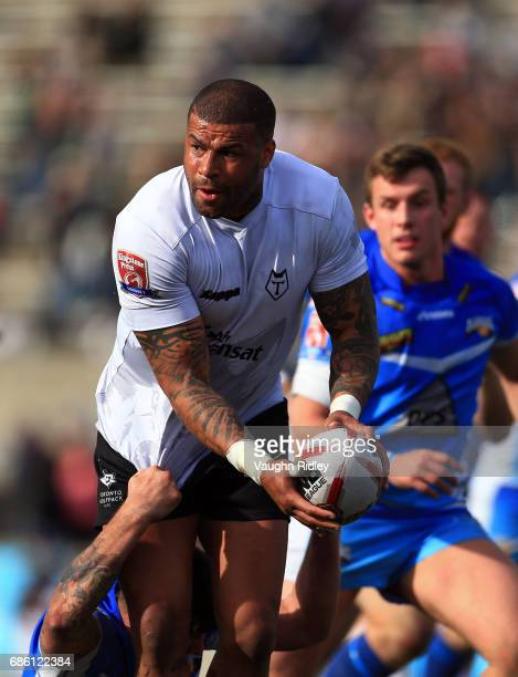 Ryan Bailey of Toronto Wolfpack passes the ball in the second half of a Kingstone Press League 1 match against Barrow Raiders at Lamport Stadium on...