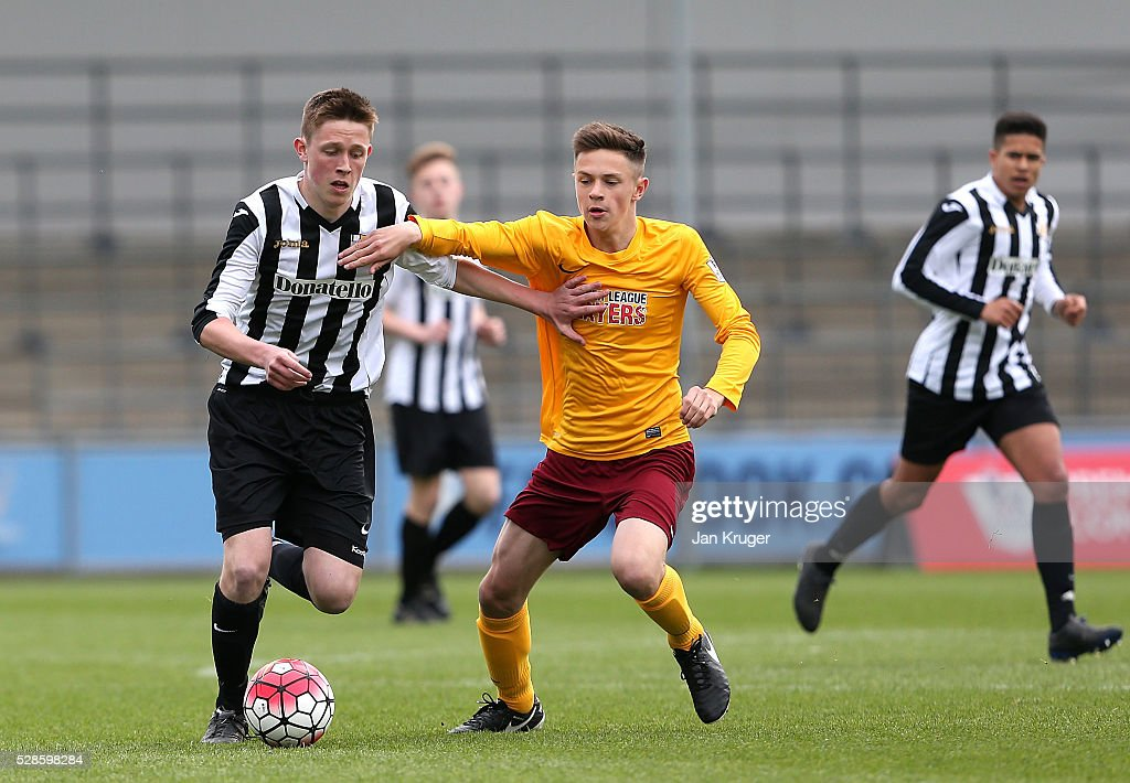 Ryan Barnett of Thomas Telford School battles with Aidan O'Donoghue of Dorothy Stringer School during the Premier League U16 Open Schools' final between Dorothy Stringer School and Thomas Telford School at the Etihad Campus on May 06, 2016 in Manchester, England.