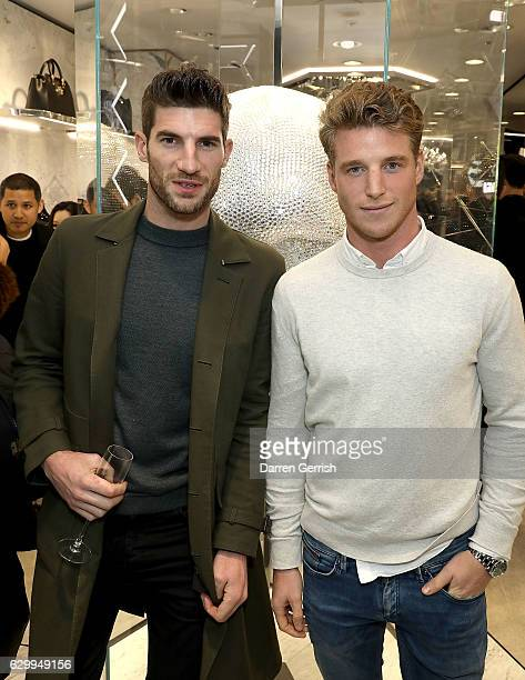 Ryan Barrett and Roger Frampton attend a cocktail party to celebrate the opening of the Philipp Plein London Boutique on December 15 2016 in London...
