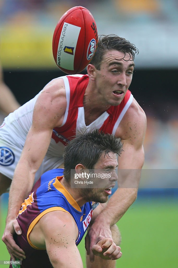 Ryan Bastinac of the Lions and Daniel Robinson of the Swans compete for the ball during the round six AFL match between the Brisbane Lions and the Sydney Swans at The Gabba on May 1, 2016 in Brisbane, Australia.