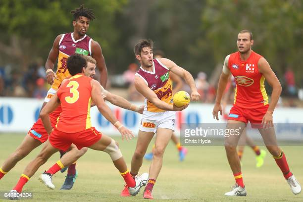 Ryan Bastinac of the Lions handballs during the 2017 JLT Community Series match at Broadbeach Sports Centre on February 19 2017 in Gold Coast...