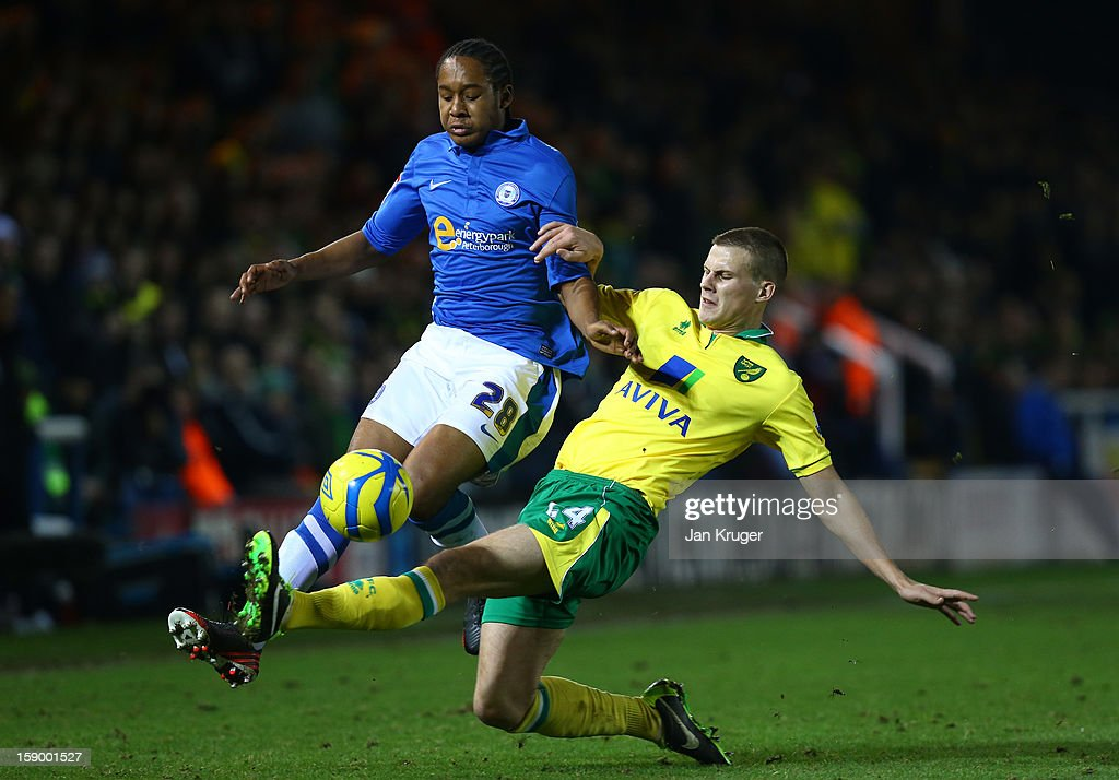 Ryan Bennett of Norwich City tackles Jaanai Gordon-Hutton of Peterborough United during the FA Cup with Budweiser third round match between Peterborough United and Norwich City at London Road Stadium on January 5, 2013 in Peterborough, England.