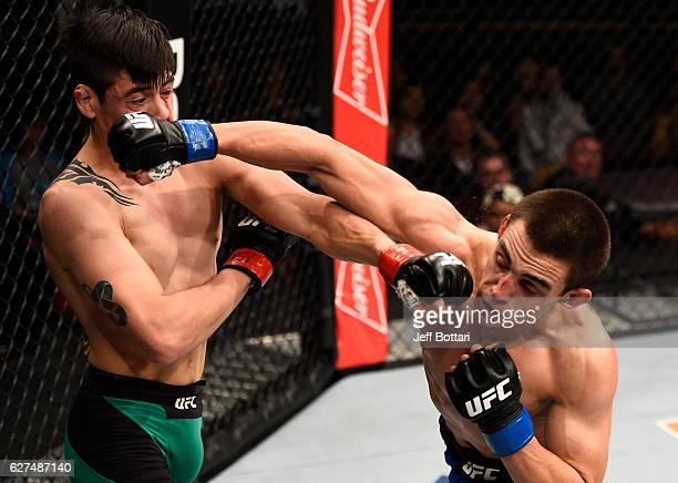 Ryan Benoit and Brandon Moreno of Mexico trade punches in their flyweight bout during The Ultimate Fighter Finale event inside the Pearl concert...