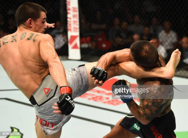 Ryan Benoit kicks Ashkan Mokhtarian of Iran in their flyweight bout during the UFC Fight Night event inside the Qudos Bank Arena on November 19 2017...