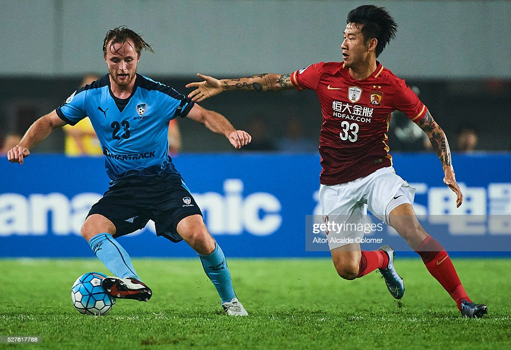 Ryan Bert Grant of Sydney FC (L) being followed by Rong Hao of Guangzhou Evergrande (R) during the AFC Asian Champions League match between Guangzhou Evergrande FC and Sydney FC at Tianhe Stadium on May 3, 2016 in Guangzhou, China.