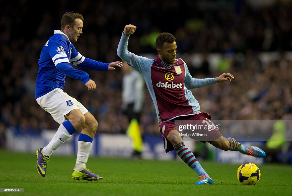 Ryan Bertrand of Aston Villa is challenged by Aiden McGready of Everton during the Barclays Premier League match between Everton and Aston Villa at Goodison Park on February 01, 2014 in Liverpool, England.