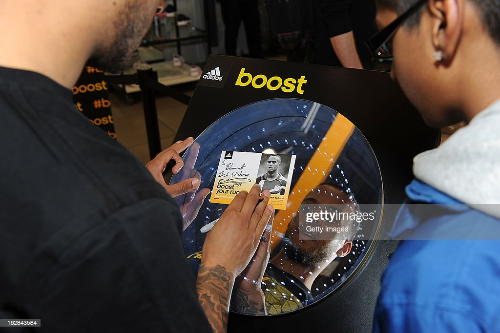 <a gi-track='captionPersonalityLinkClicked' href=/galleries/search?phrase=Ryan+Bertrand&family=editorial&specificpeople=1820135 ng-click='$event.stopPropagation()'>Ryan Bertrand</a> of Chelsea signs autographs at the adidas Boost Launch at the Westfield shopping centre on February 28, 2013 in London, England.
