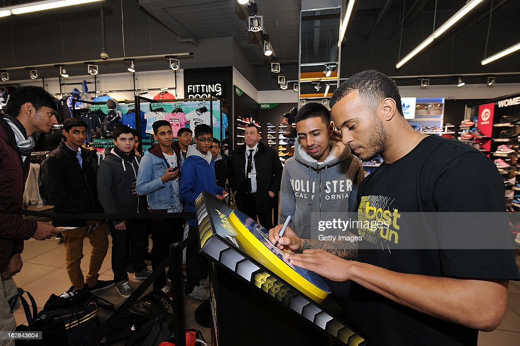 Ryan Bertrand of Chelsea signs autographs at the adidas Boost Launch at the Westfield shopping centre on February 28, 2013 in London, England.