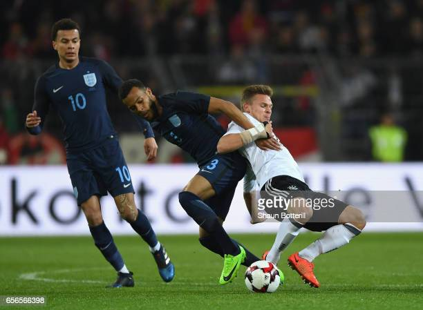 Ryan Bertrand of England and Joshua Kimmich of Germany battle for possession during the international friendly match between Germany and England at...