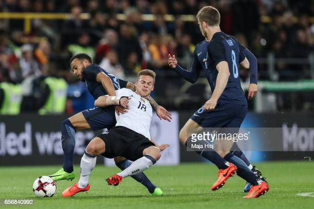 Ryan Bertrand of England and Joshua Kimmich of Germany battle for the ball during the international friendly match between Germany and England at...