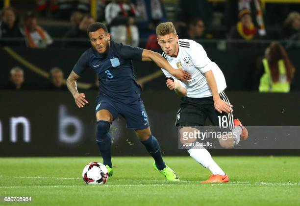 Ryan Bertrand of England and Joshua Kimmich of Germany in action during the international friendly match between Germany and England at Signal Iduna...