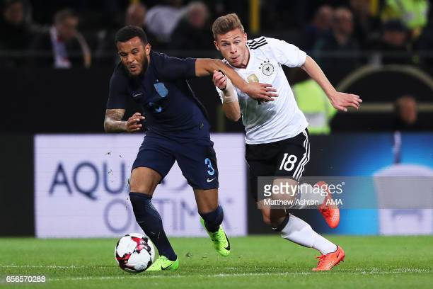Ryan Bertrand of England competes with Joshua Kimmich of Germany during the international friendly match between Germany and England at Signal Iduna...