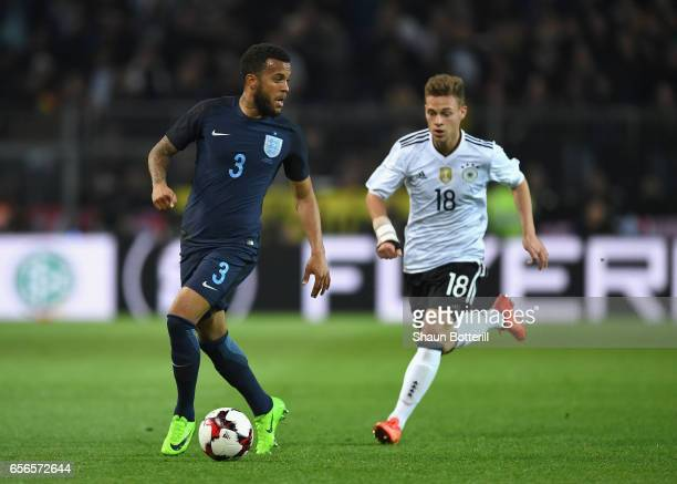 Ryan Bertrand of England is chased down by Joshua Kimmich of Germany during the international friendly match between Germany and England at Signal...