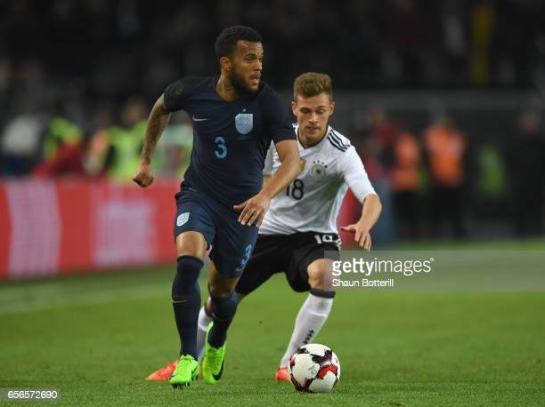 Ryan Bertrand of England is put under pressure from Joshua Kimmich of Germany during the international friendly match between Germany and England at...