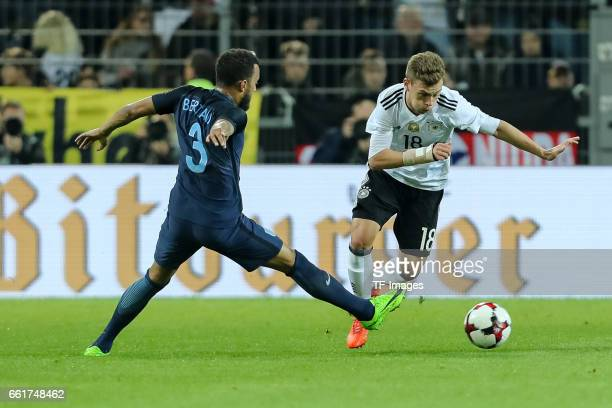 Ryan Bertrand of England und Joshua Kimmich of Germany battle for the ball during the international friendly match between Germany and England at...