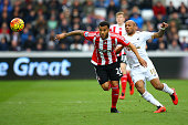 Ryan Bertrand of Southampton and Andre Ayew of Swansea City compete for the ball during the Barclays Premier League match between Swansea City and...