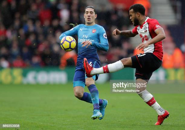 Ryan Bertrand of Southampton and Hector Bellerin of Arsenal battle for the ball during the Premier League match between Southampton and Arsenal at St...