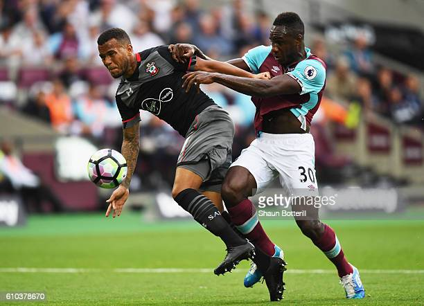 Ryan Bertrand of Southampton and Michail Antonio of West Ham United battle for the ball during the Premier League match between West Ham United and...