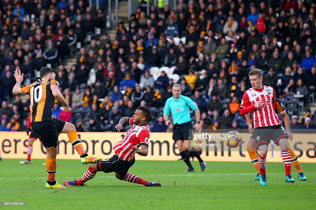 Ryan Bertrand of Southampton attempts to block as Robert Snodgrass of Hull City scores his sides first goal during the Premier League match between Hull City and Southampton at KC Stadium on November 6, 2016 in Hull, England.