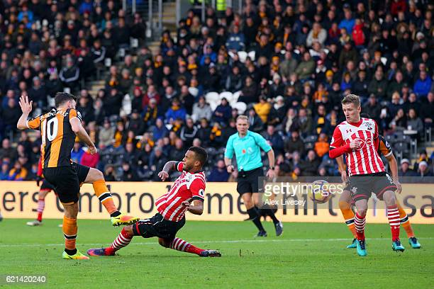 Ryan Bertrand of Southampton attempts to block as Robert Snodgrass of Hull City scores his sides first goal during the Premier League match between...