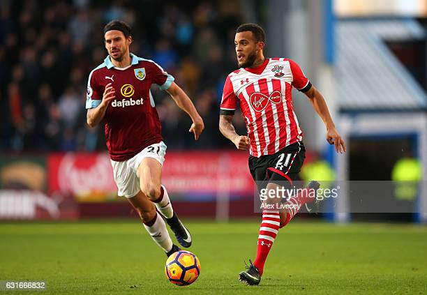 Ryan Bertrand of Southampton attempts to get away from George Boyd of Burnley during the Premier League match between Burnley and Southampton at Turf...