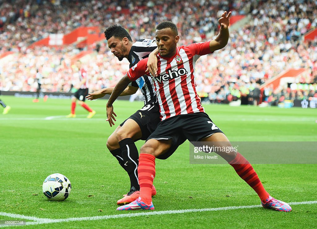 Ryan Bertrand of Southampton battles with Emmanuel Riviere of Newcastle United during the Barclays Premier League match between Southampton and...