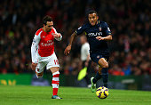 Ryan Bertrand of Southampton runs with the ball past Santi Cazorla of Arsenal during the Barclays Premier League match between Arsenal and...