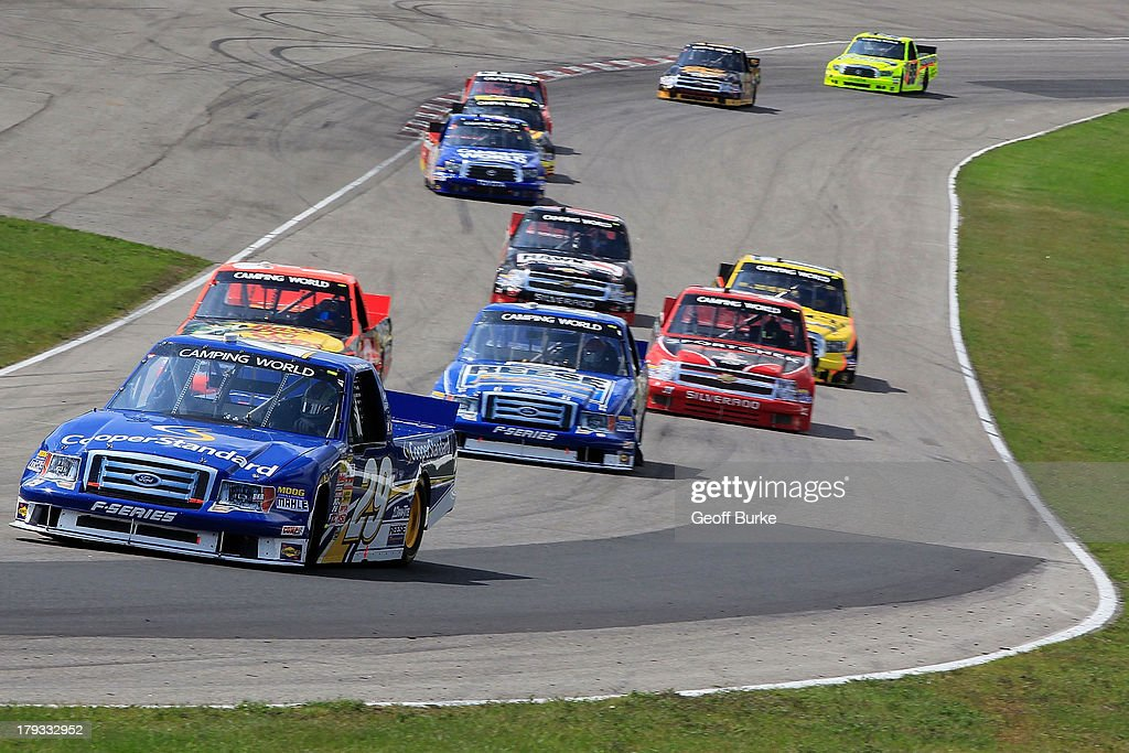Ryan Blaney, driver of the #29 Cooper Standard Ford, leads a group of trucks during the NASCAR Camping World Truck Series Chevrolet Silverado 250 at Canadian Tire Motorsport Park on September 1, 2013 in Bowmanville, Canada.