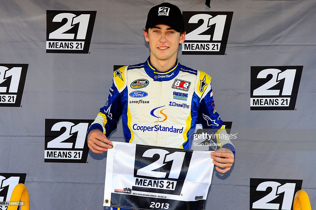 Ryan Blaney, driver of the #29 Cooper Standard Ford, poses with the 21 Means 21 Pole Award after qualifying for pole position for the NASCAR Camping World Truck Series UNOH 225 at Kentucky Speedway on June 27, 2013 in Sparta, Kentucky.