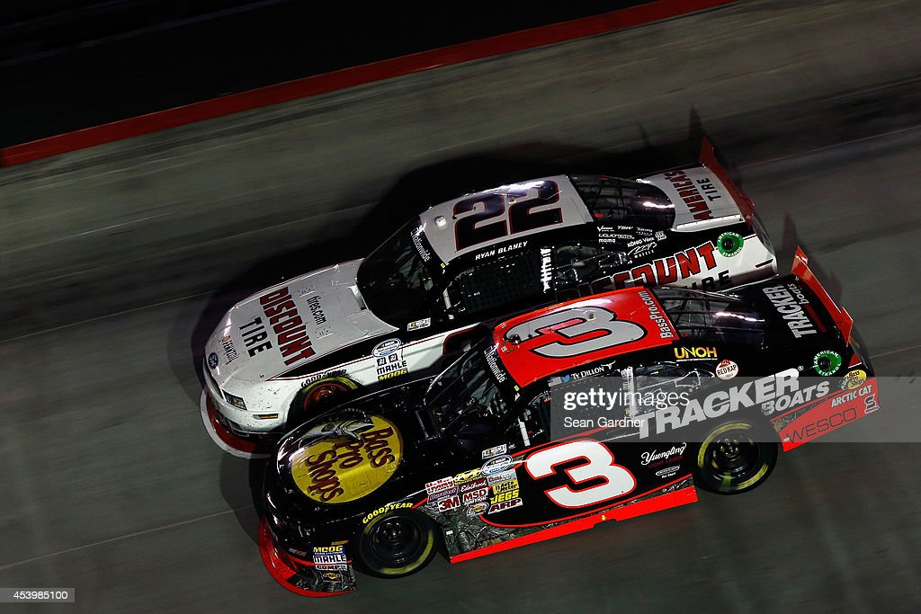 <a gi-track='captionPersonalityLinkClicked' href=/galleries/search?phrase=Ryan+Blaney&family=editorial&specificpeople=8626930 ng-click='$event.stopPropagation()'>Ryan Blaney</a>, driver of the #22 Discount Tire Ford, and <a gi-track='captionPersonalityLinkClicked' href=/galleries/search?phrase=Ty+Dillon&family=editorial&specificpeople=6312493 ng-click='$event.stopPropagation()'>Ty Dillon</a>, driver of the #3 Bass Pro Shops Chevrolet, race during the NASCAR Nationwide Series Food City 300 at Bristol Motor Speedway on August 22, 2014 in Bristol, Tennessee.