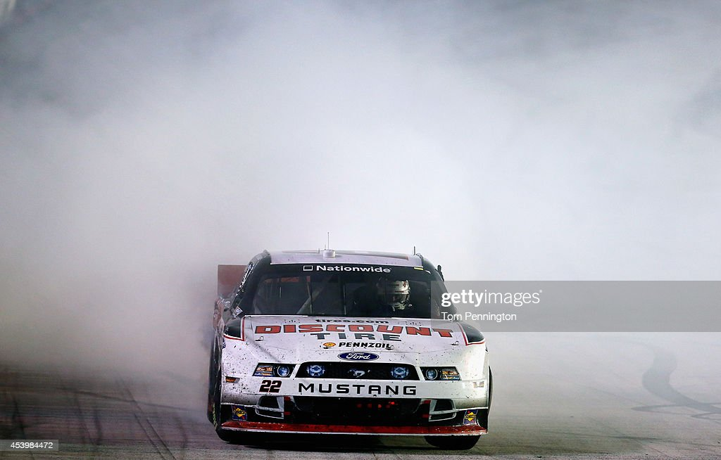 <a gi-track='captionPersonalityLinkClicked' href=/galleries/search?phrase=Ryan+Blaney&family=editorial&specificpeople=8626930 ng-click='$event.stopPropagation()'>Ryan Blaney</a>, driver of the #22 Discount Tire Ford, celebrates with a burnout after winning the NASCAR Nationwide Series Food City 300 at Bristol Motor Speedway on August 22, 2014 in Bristol, Tennessee.