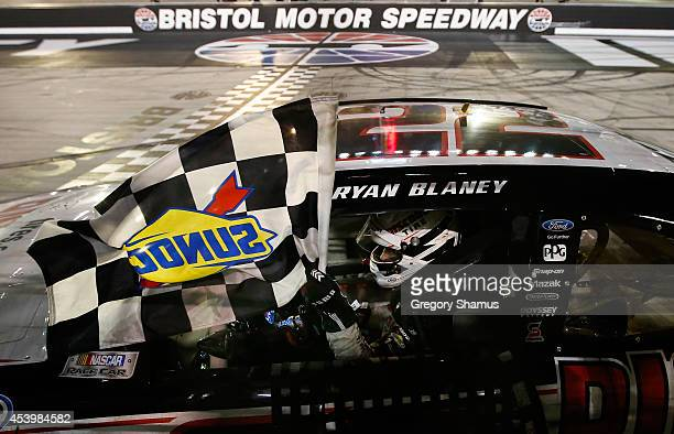 Ryan Blaney driver of the Discount Tire Ford celebrates with the checkered flag after winning the NASCAR Nationwide Series Food City 300 at Bristol...