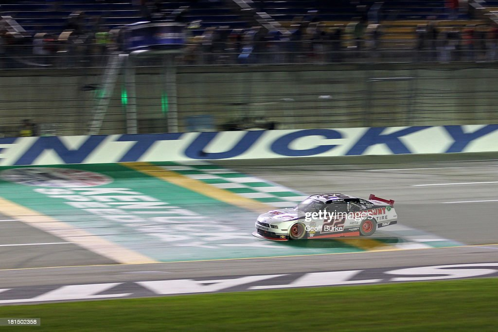 Ryan Blaney driver of the Discount Tire Ford crosse stye finish line to win the NASCAR Nationwide Series Kentucky 300 at Kentucky Speedway on...