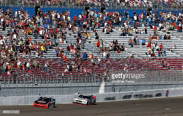Ryan Blaney driver of the Discount Tire Ford hits the wall on the last lap behind Austin Dillon driver of the Rheem Chevrolet during the NASCAR...