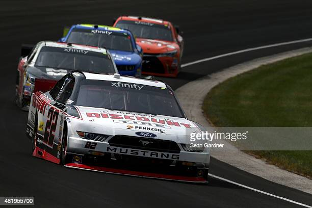 Ryan Blaney driver of the Discount Tire Ford leads a pack of cars during the NASCAR XFINITY Series Lilly Diabetes 250 at Indianapolis Motor Speedway...