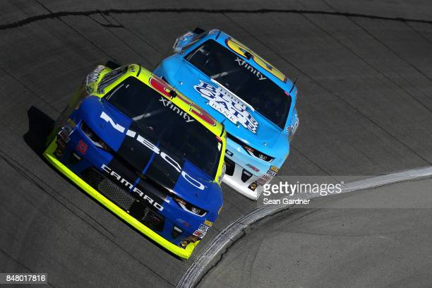 Ryan Blaney driver of the Discount Tire Ford leads Daniel Hemric driver of the Blue Gate Bank Chevrolet during the NASCAR XFINITY Series TheHousecom...
