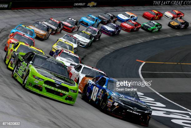 Ryan Blaney driver of the Fitzgerald Glider Kits Ford and Daniel Suarez driver of the Juniper Toyota lead the field during the NASCAR XFINITY Series...