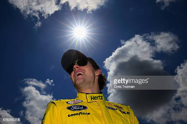Ryan Blaney driver of the Hertz Ford walks on the grid prior to qualifying for the NASCAR XFINITY Series Buckle Up 200 presented by Click It or...