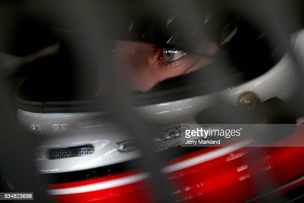 Ryan Blaney driver of the Motorcraft/Quick Lane Tire and Auto Center Ford sits in his car during practice for the NASCAR Sprint Cup Series CocaCola...