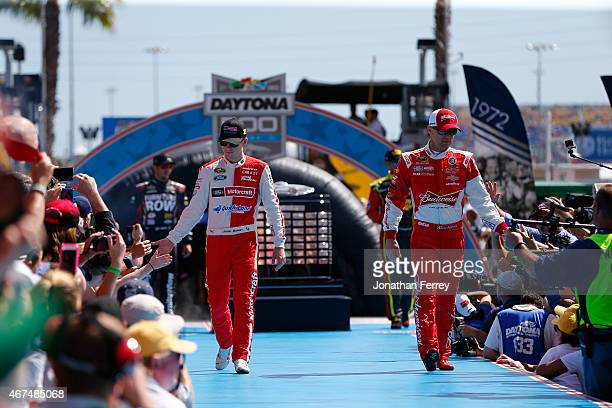 Ryan Blaney driver of the Motorcraft/Quick Lane Tire Auto Center Ford and Kevin Harvick driver of the Budweiser/Jimmy John's Chevrolet greets fans...
