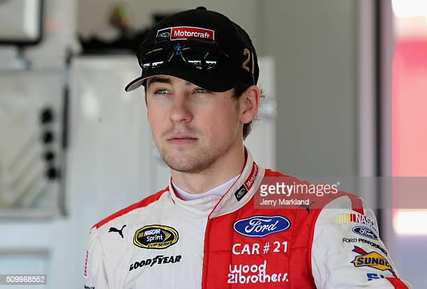 Ryan Blaney driver of the Motorcraft/Quick Lane Tire Auto Center Ford looks on in the garage area during practice for the NASCAR Sprint Cup Series...