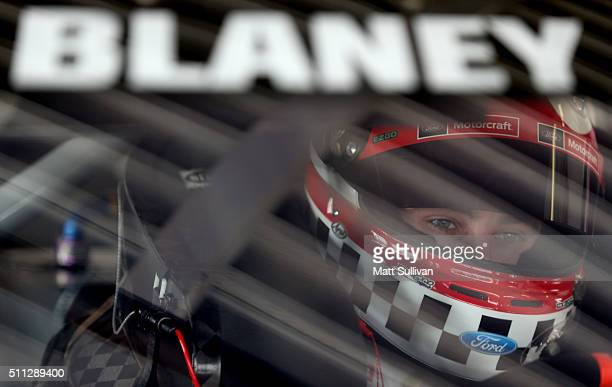 Ryan Blaney driver of the Motorcraft/Quick Lane Tire Auto Center Ford sits in his car during practice for the NASCAR Sprint Cup Series Daytona 500 at...
