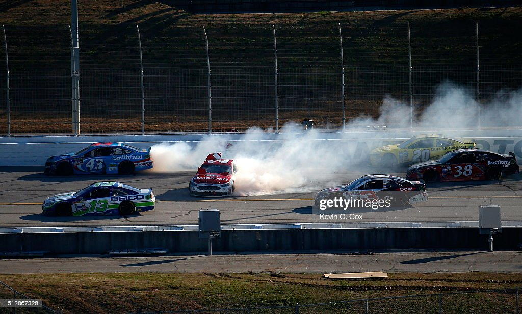Ryan Blaney, driver of the #21 Motorcraft/Quick Lane Tire & Auto Center Ford, and Aric Almirola, driver of the #43 Smithfield Ford, are involved in an on-track incident during the NASCAR Sprint Cup Series Folds of Honor QuikTrip 500 at Atlanta Motor Speedway on February 28, 2016 in Hampton, Georgia.